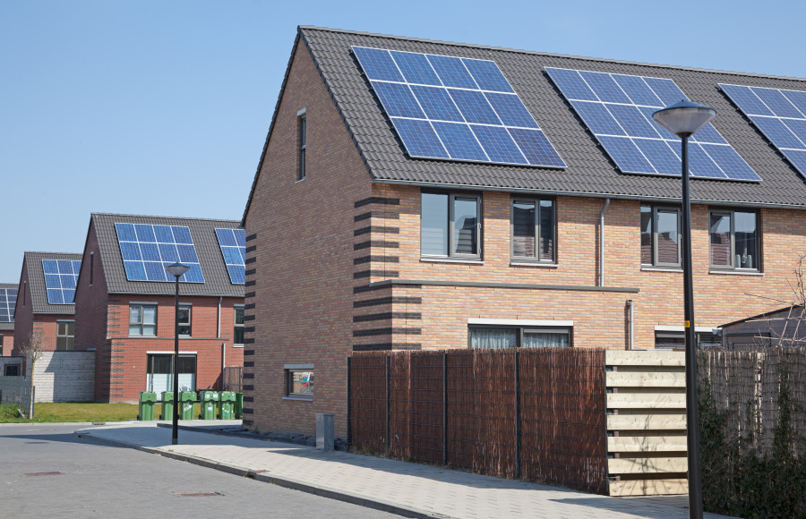 Image of new houses showing photovoltaics on the roof